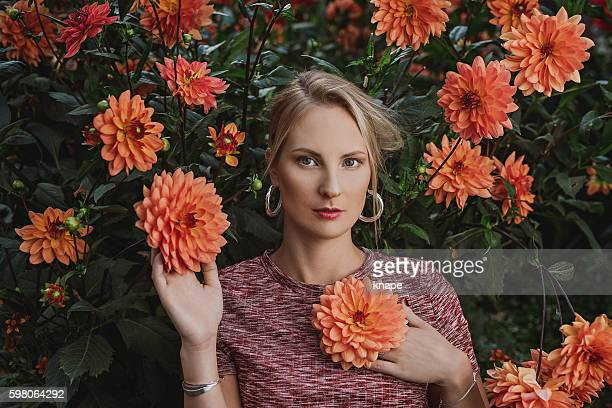 Beautiful woman with a dahlias
