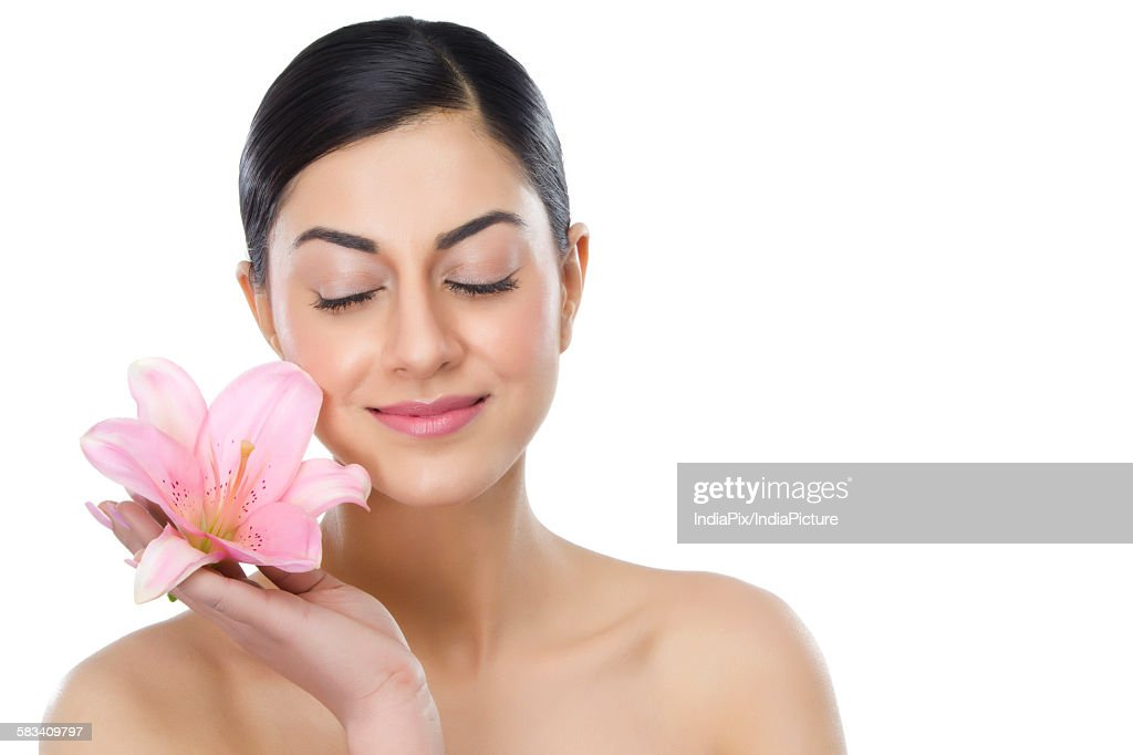 Beautiful woman with a flower : Stock Photo