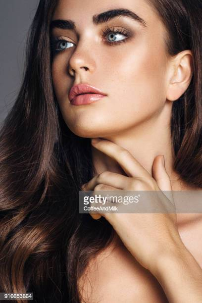 beautiful woman with amazing curly long hair - stage make up stock photos and pictures
