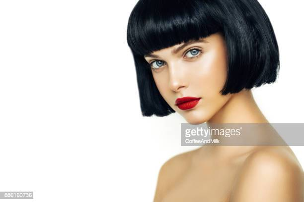 beautiful woman with black short hair - red lipstick stock pictures, royalty-free photos & images