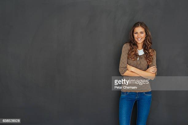 Beautiful woman with blackboard copy space