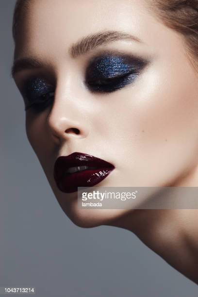 beautiful woman with bright make-up - eyeshadow stock pictures, royalty-free photos & images