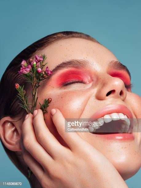 beautiful woman with bright make-up - bright beautiful flowers stock pictures, royalty-free photos & images