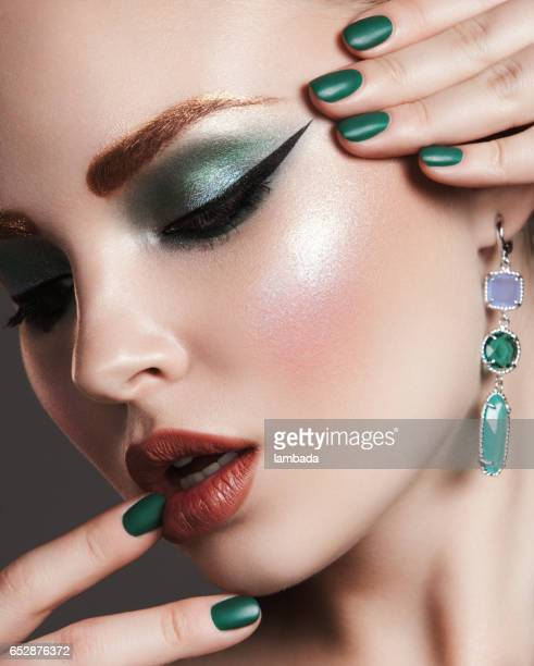 beautiful woman with bright make-up - stage make up stock photos and pictures