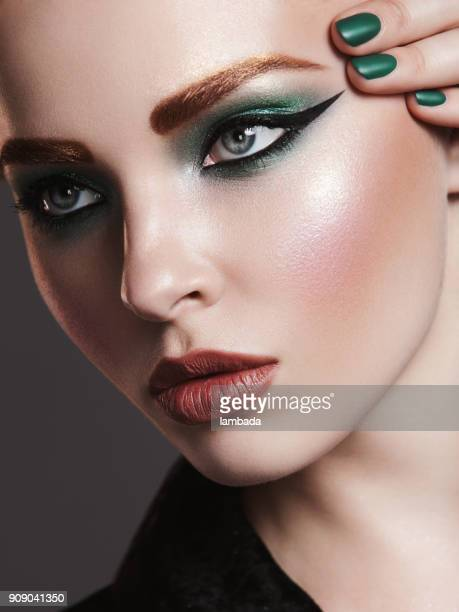 beautiful woman with bright make-up - eye liner stock photos and pictures