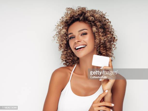 beautiful woman with business card - beautiful bare women stock pictures, royalty-free photos & images