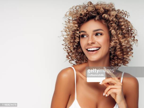 beautiful woman with business card - greeting card stock pictures, royalty-free photos & images