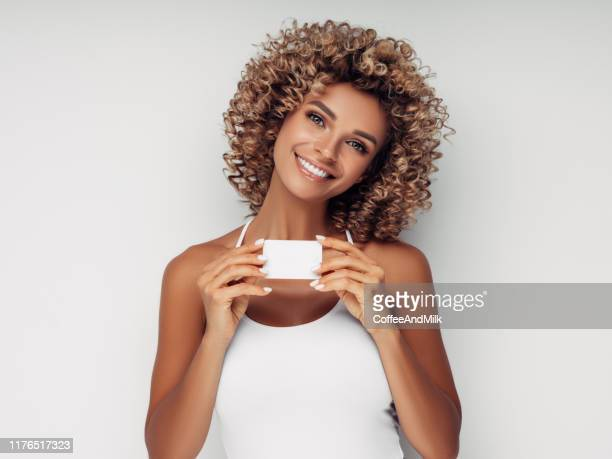 beautiful woman with business card - femininity stock pictures, royalty-free photos & images