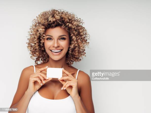 beautiful woman with business card - thinking of you card stock pictures, royalty-free photos & images