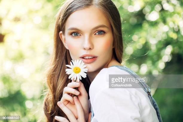 Beautiful woman with camomile