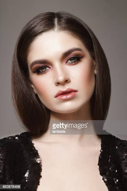 beautiful woman with cat-eye make-up - eye make up stock photos and pictures