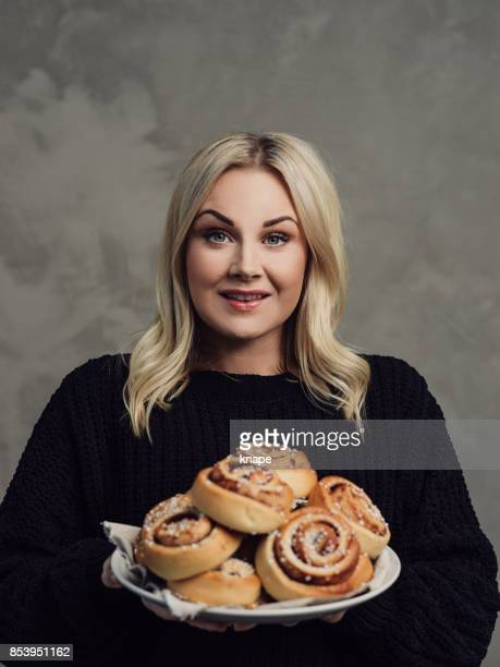 Beautiful woman with cinnamon buns