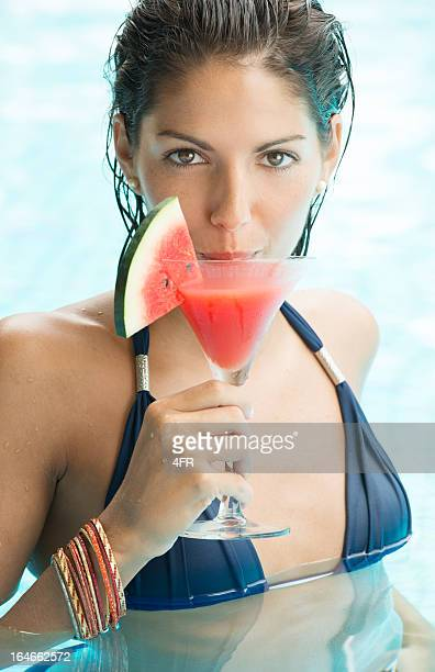 Beautiful Woman with cocktail at the Pool on Spring Break