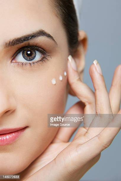 Beautiful woman with cream on her face