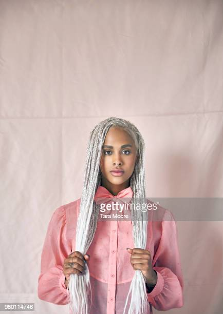 beautiful woman with dreadlocks and pink shirt