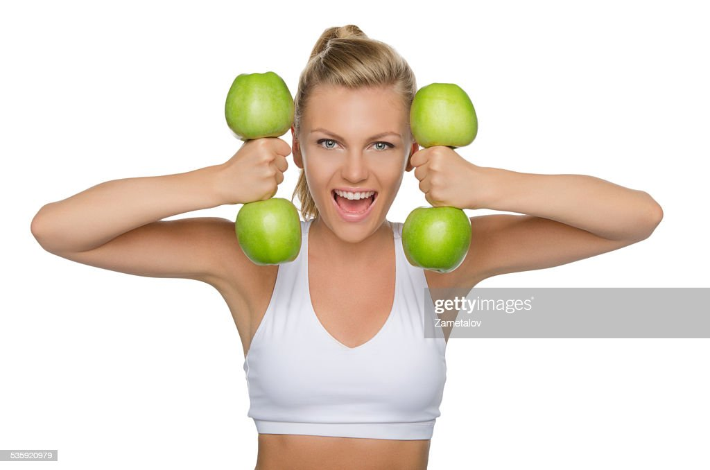 Beautiful woman with dumbbells from ripe apples : Stock Photo