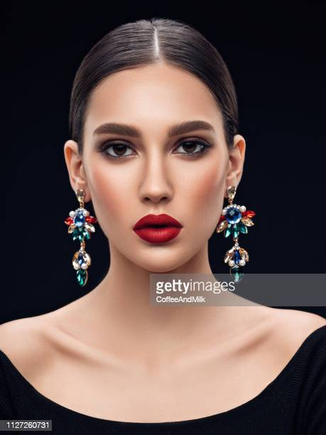 beautiful woman with earring - haute couture stock pictures, royalty-free photos & images