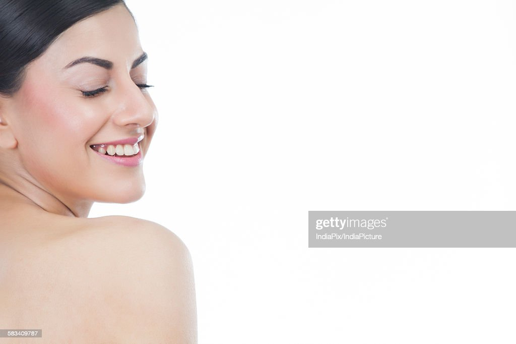 Beautiful woman with eyes closed smiling : Stock Photo