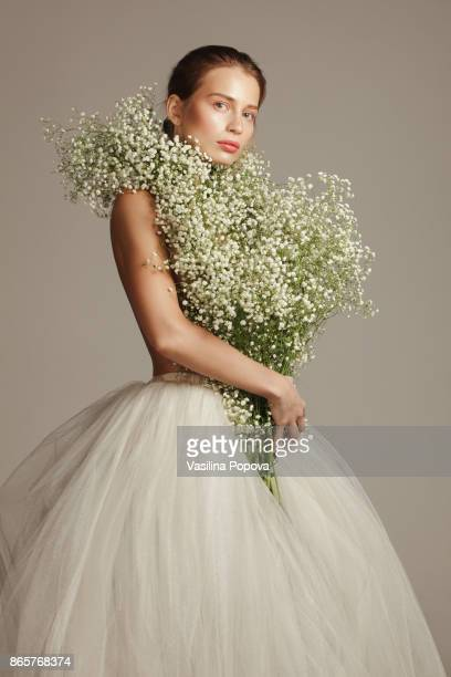 Beautiful woman with flower bouquet