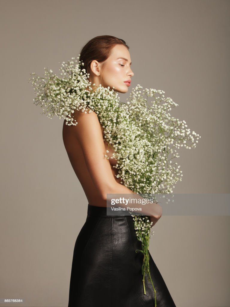Beautiful woman with flower bouquet stock photo getty images beautiful woman with flower bouquet stock photo izmirmasajfo Image collections