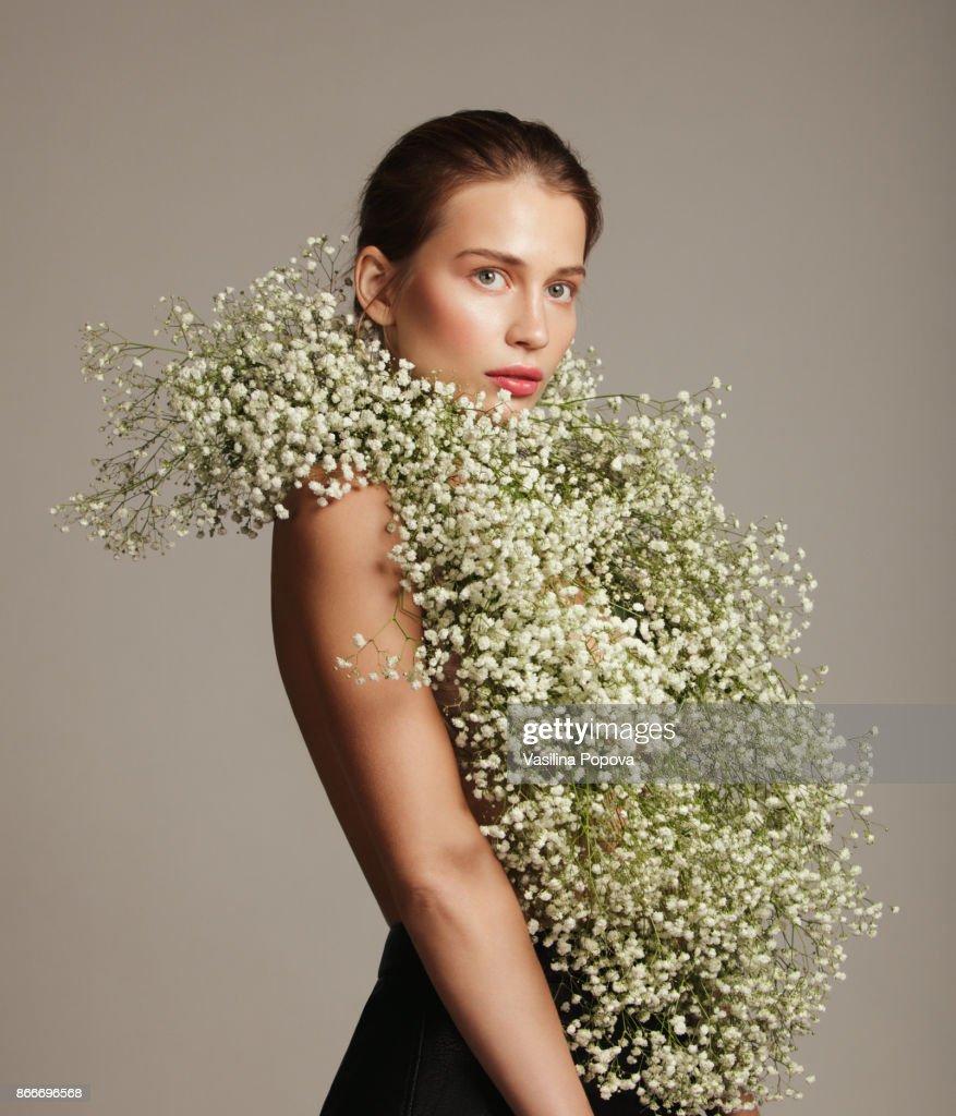 Beautiful woman with flower bouquet stock photo getty images beautiful woman with flower bouquet stock photo izmirmasajfo