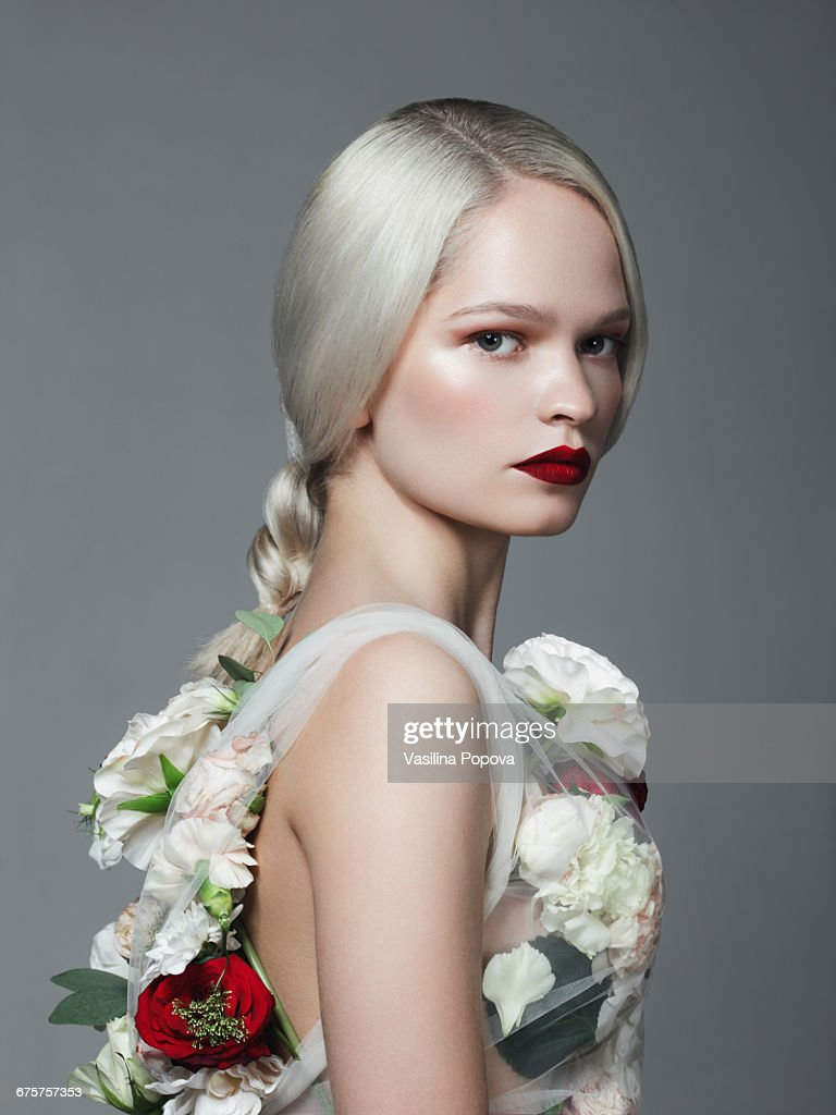 Beautiful woman with flower dress stock photo getty images beautiful woman with flower dress stock photo izmirmasajfo Image collections