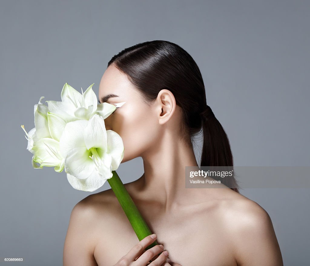 Beautiful woman with flower stock photo getty images beautiful woman with flower stock photo izmirmasajfo Image collections