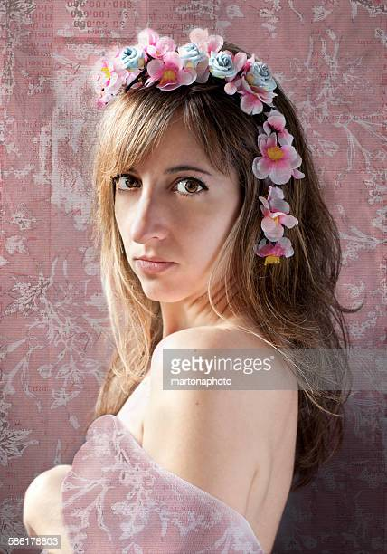 Beautiful woman with flowers on head
