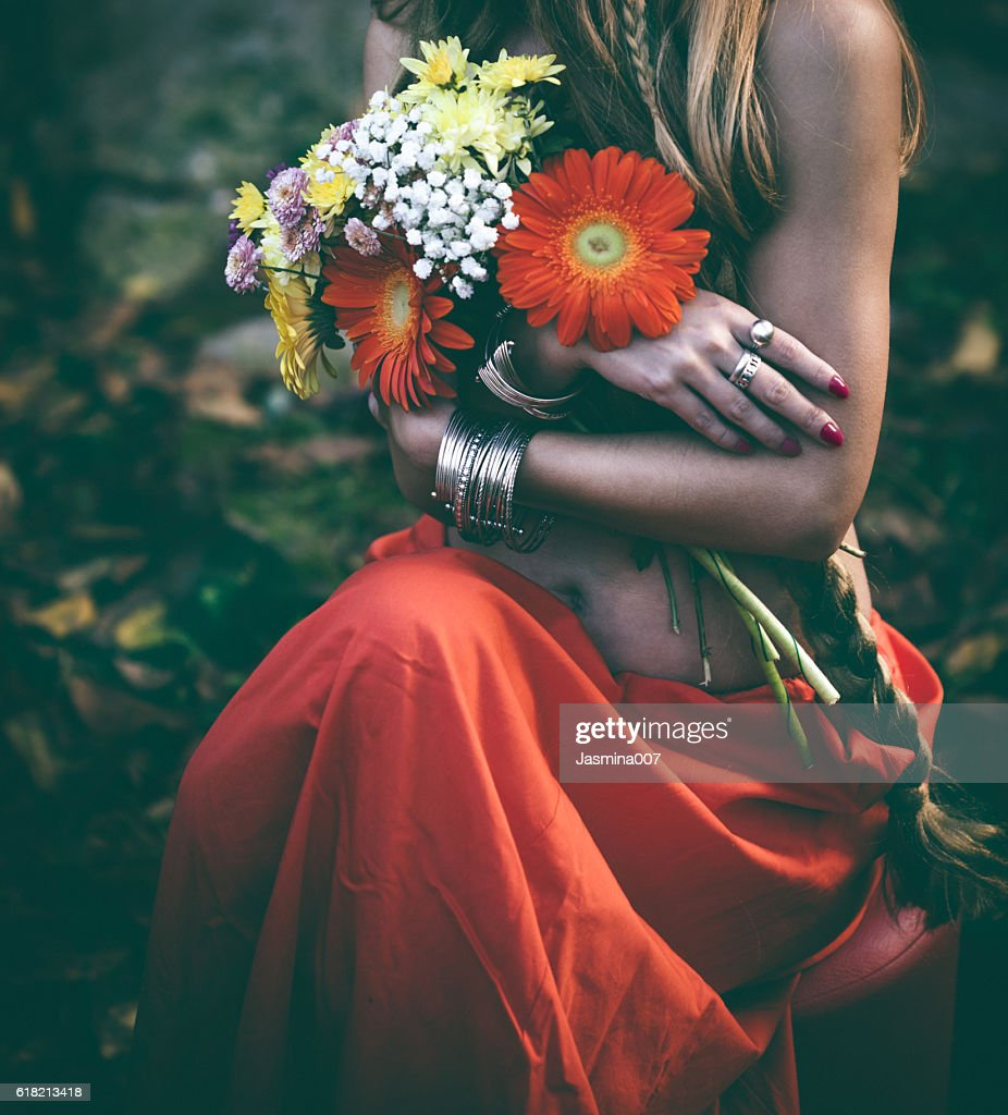 Beautiful woman with flowers stock photo getty images beautiful woman with flowers stock photo izmirmasajfo Image collections