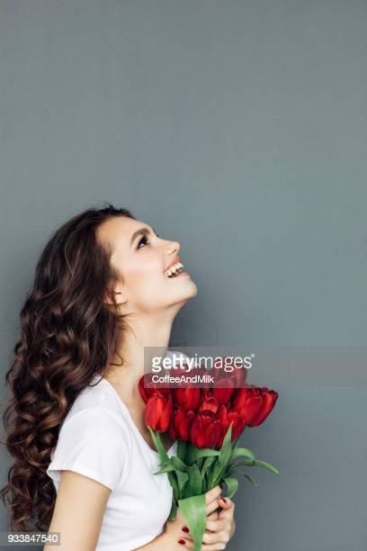 Schöne Frau mit Blumen