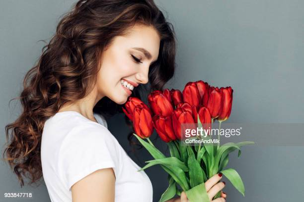 beautiful woman with flowers - red roses stock pictures, royalty-free photos & images