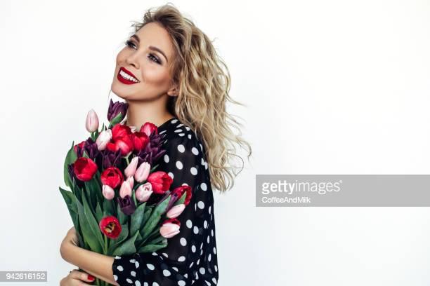 beautiful woman with flowers - donne di età media foto e immagini stock