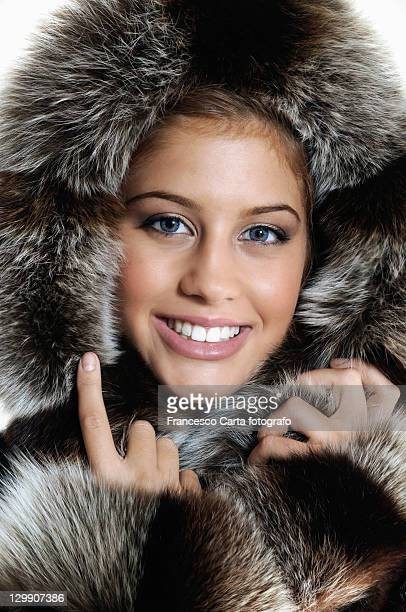 Beautiful woman with fur winter.