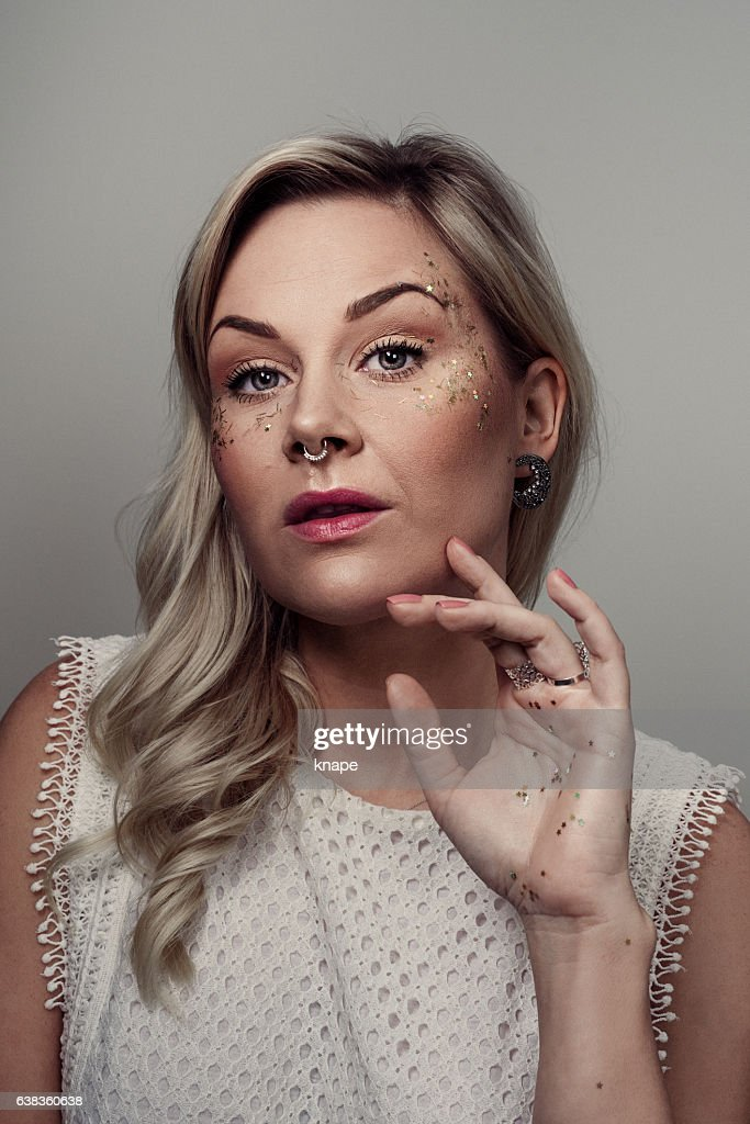 Beautiful woman with glitter make up and nose piercing : Stock Photo