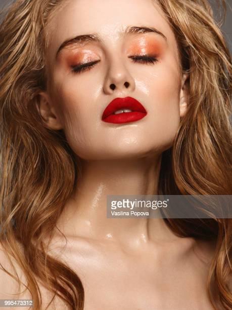 Beautiful woman with glossy bright make-up