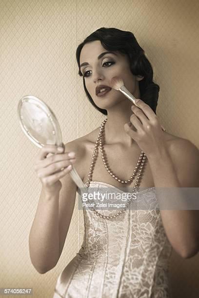 beautiful woman with hand mirror - korsett stock-fotos und bilder