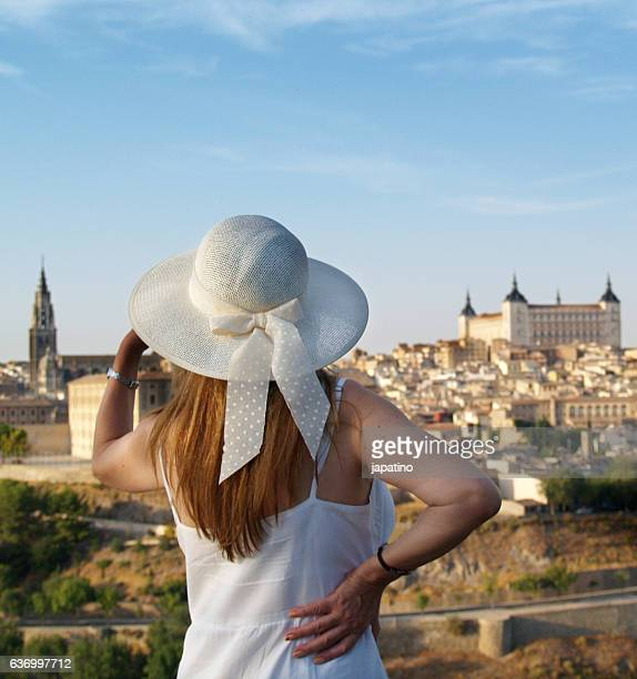 Beautiful woman with hat admiring the beautiful city of Toledo
