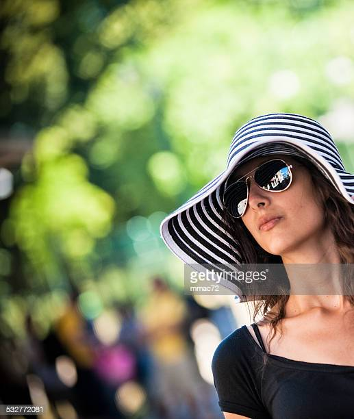 Beautiful Woman with Hat and Sunglasses