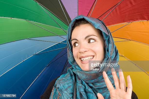 beautiful woman with headscarf and umbrella - pavliha stock photos and pictures