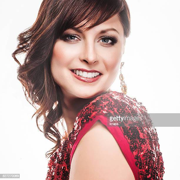 beautiful woman with in red dress - sequin dress stock pictures, royalty-free photos & images