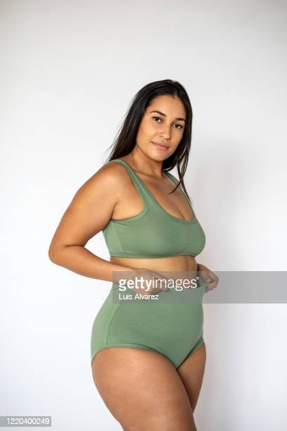 beautiful woman with large body wearing lingerie - knickers stock pictures, royalty-free photos & images