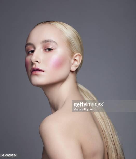 Beautiful woman with light pink make-up