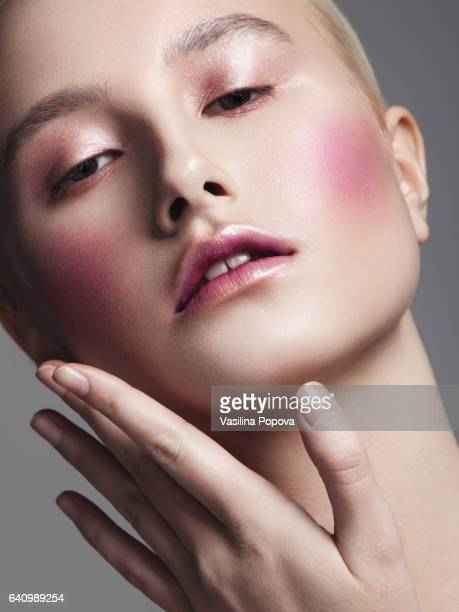 Beautiful woman with light pink make-up