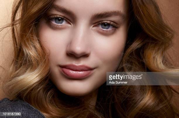beautiful woman with long dark blond wavy hair