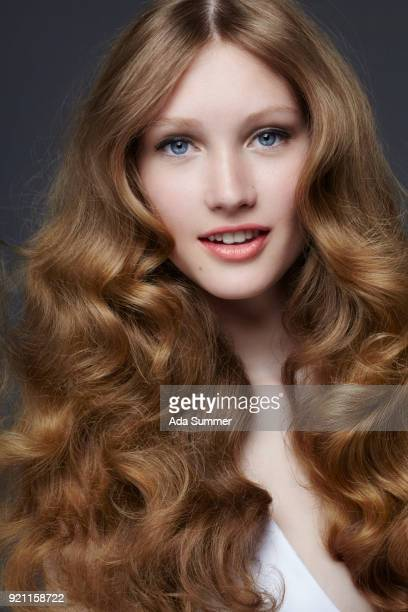 beautiful woman with long wavy dark blonde hair