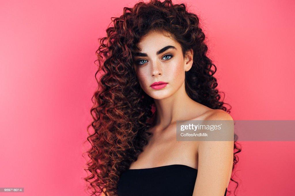 Beautiful woman with lush hairstyle : Stock Photo