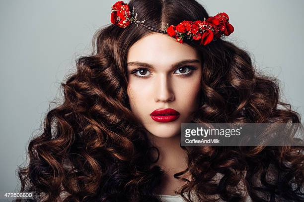 Beautiful woman with luxurious curls