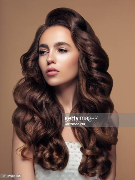 beautiful woman with luxury hair - hair stock pictures, royalty-free photos & images