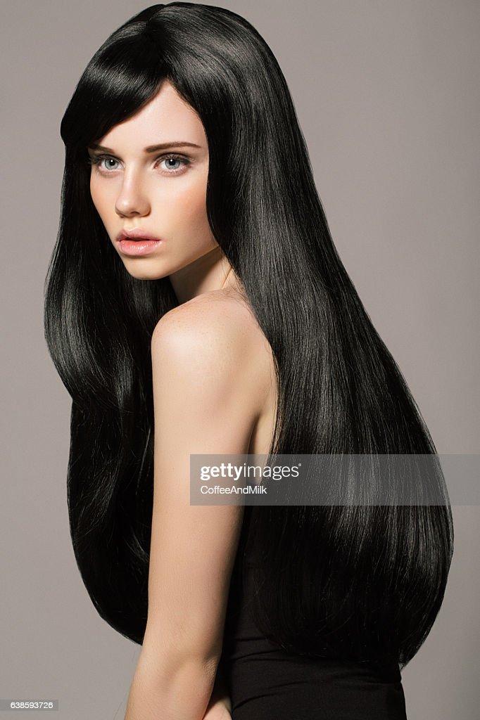 Schöne Frau mit Haaren Luxus  : Stock-Foto
