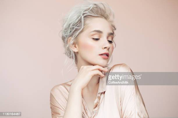 beautiful woman with make-up and stylish hairstyle - evening gown stock pictures, royalty-free photos & images